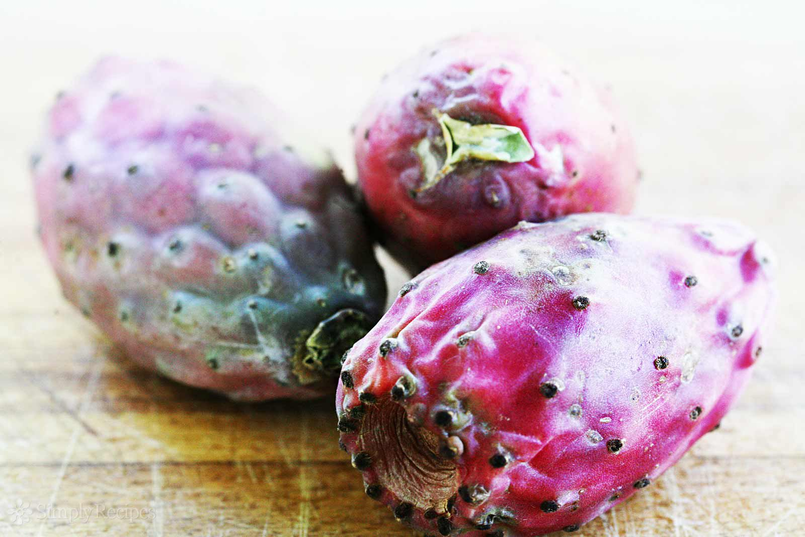 Cactus Pear or prickly pear fruit on cutting board