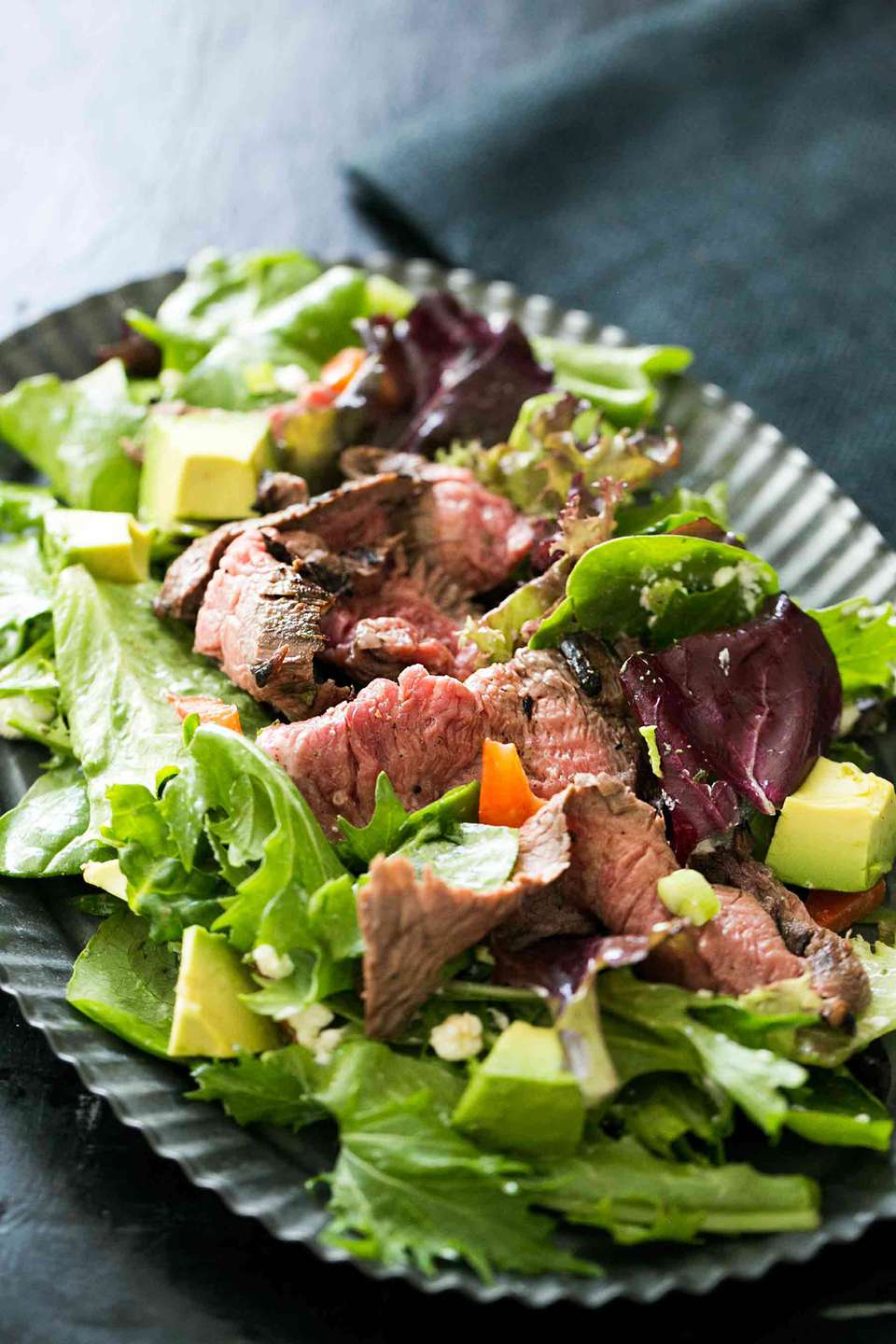 Steak Salad with pan-seared flank steak on a bed of greens and tossed with a lemon vinaigrette