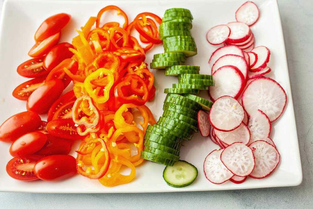 Easy Instant Pot Barley Lunch Jars - platter of slices tomatoes peppers cucumbers radishes