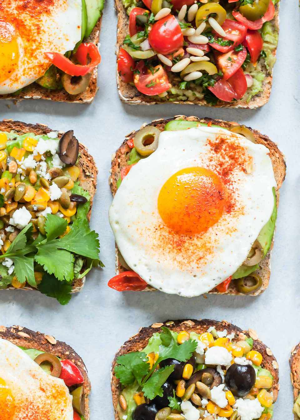 Avocado Toast with Fried Egg, Olives, and Paprika