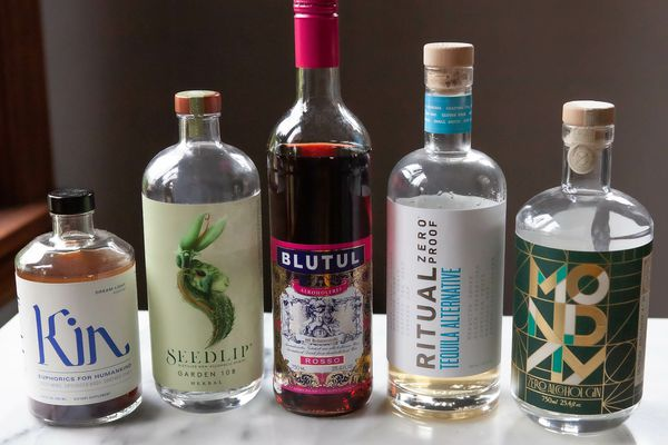 Non-alcoholic spirits lined up on a table.