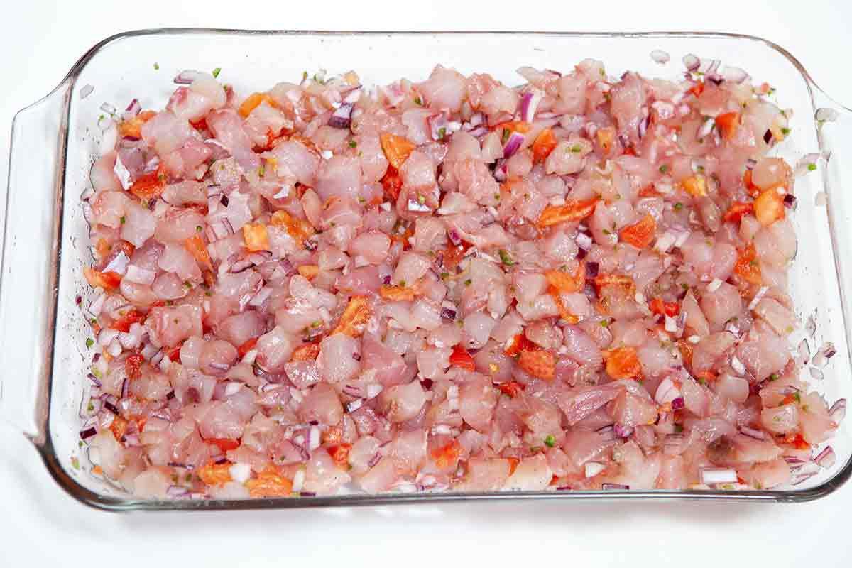 Combine the fish, onion, tomatoes, chili, salt, Tabasco, and oregano for the ceviche in a non-reactive dish