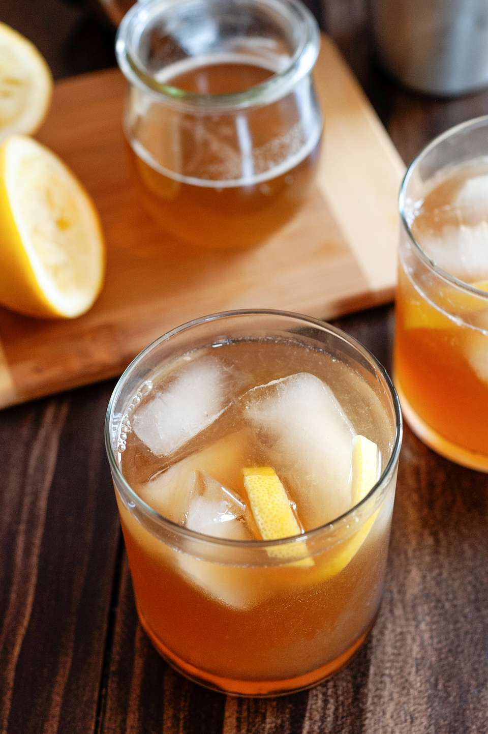Essential bourbon cocktail: The Gold Rush served with ice and lemon.