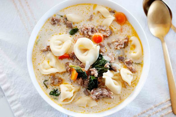 Bowl of easy homemade creamy tortellini soup with sausage, carrots, and spinach