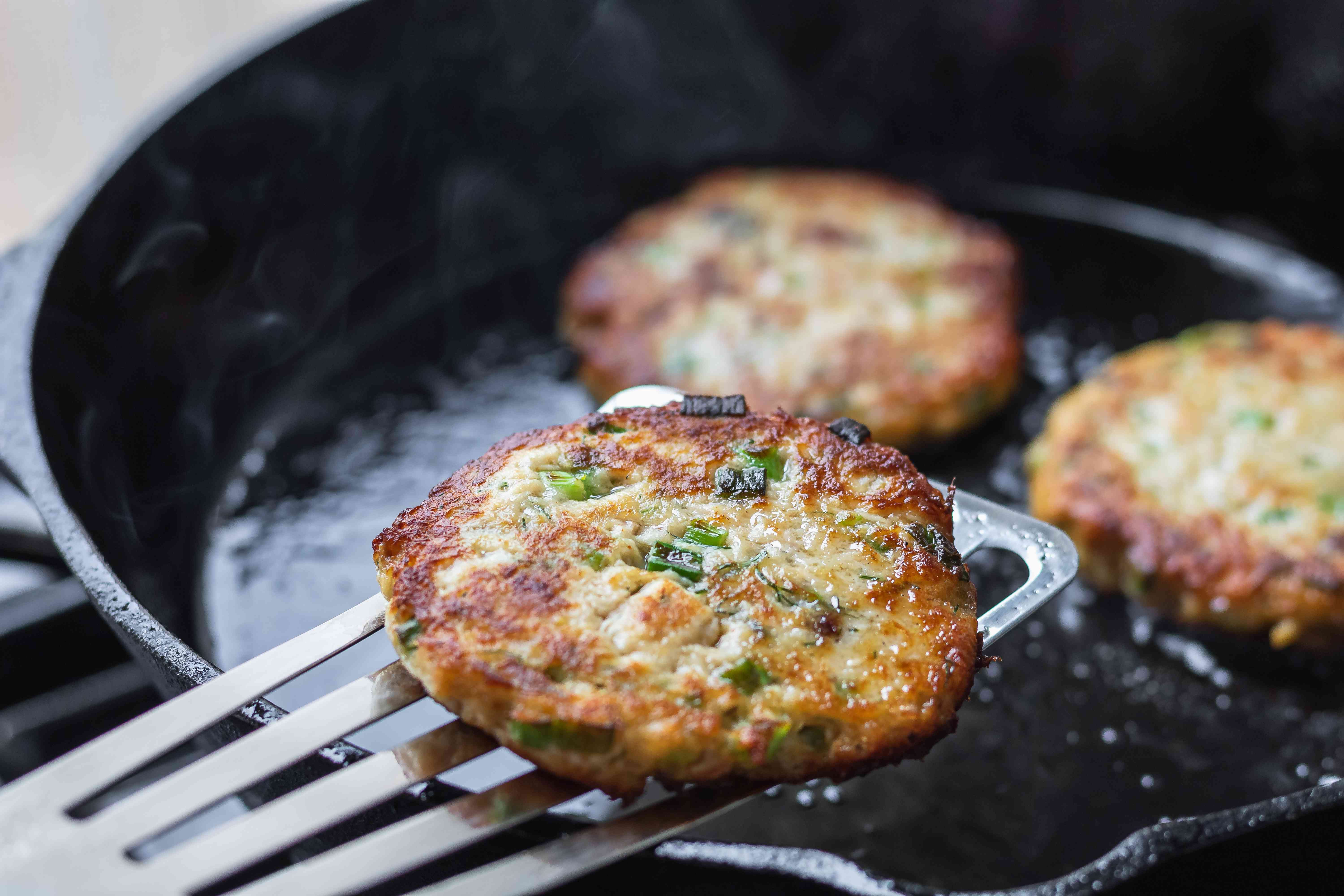 How to make salmon cakes and lifting the pan fried cakes out of the pan.