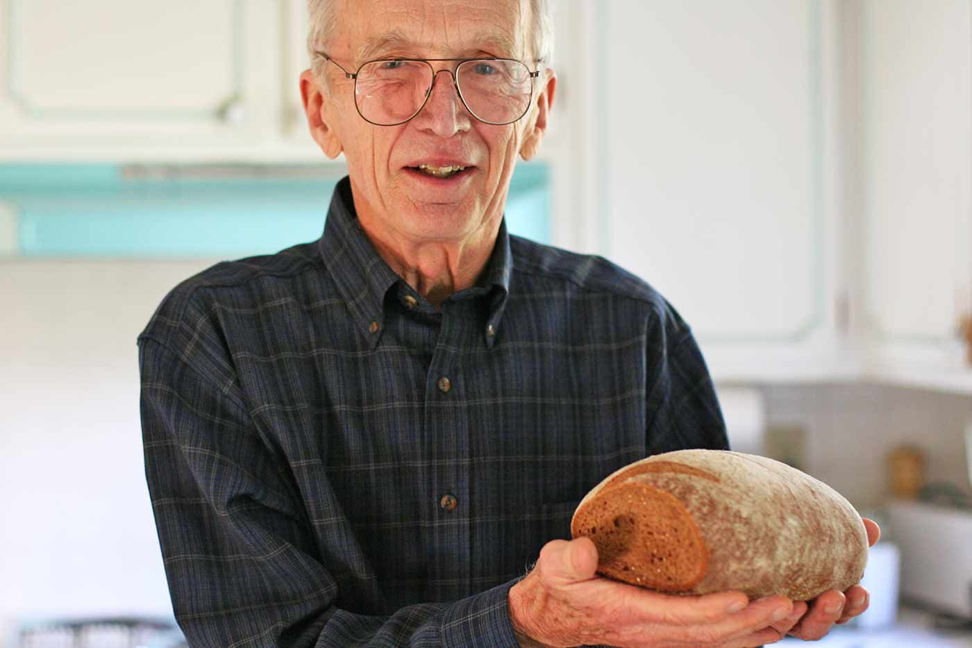 George holding his rye bread