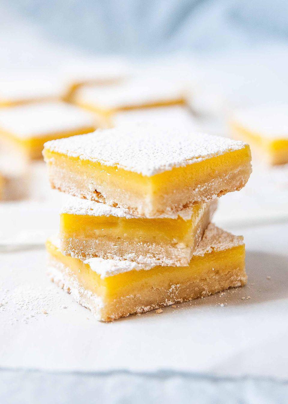Best Lemon Bars - lemon bars stacked on top of each other
