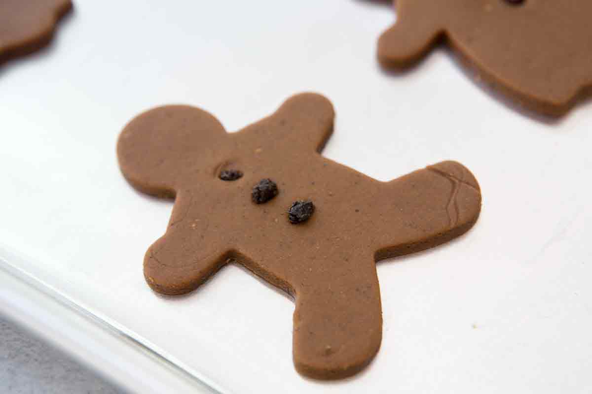 Close up on raw gingerbread man shape cookie dough