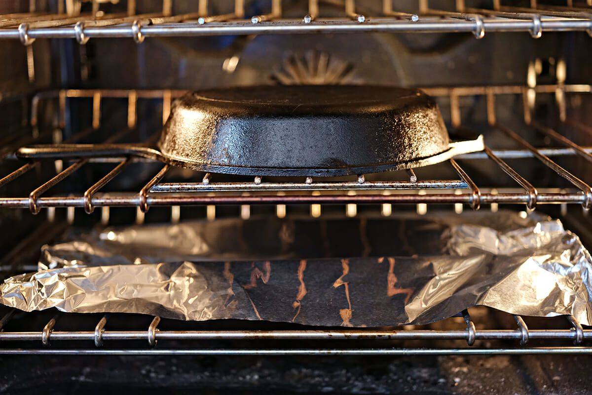 How to Clean a Cast Iron Skillet - cast iron skillet upside down in oven