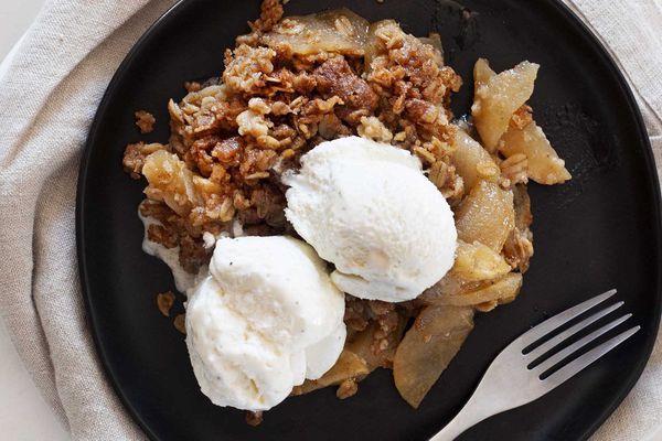 Apple crisp recipe topped with vanilla ice cream.