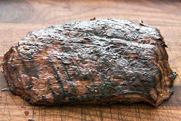 Letting grilled flank steak rest on cutting board