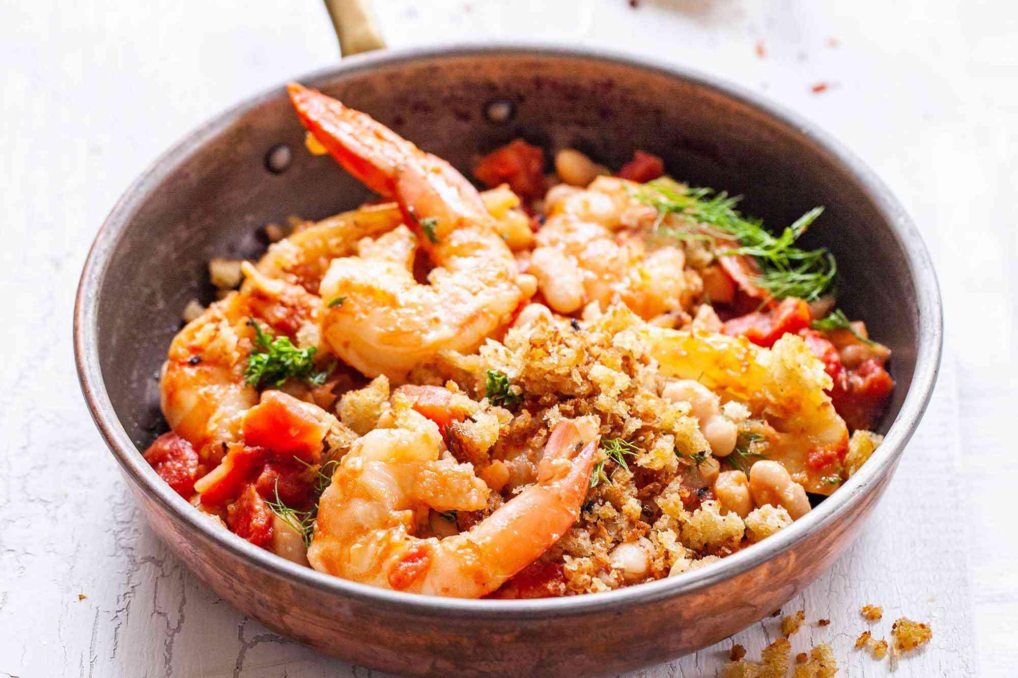 Mediterranean Shrimp Skillet Dinner - shrimp, breadcrumbs, vegetables, tomatoes and beans in skillet