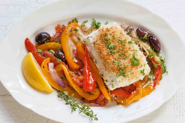 Halibut with peppers and onion on plate