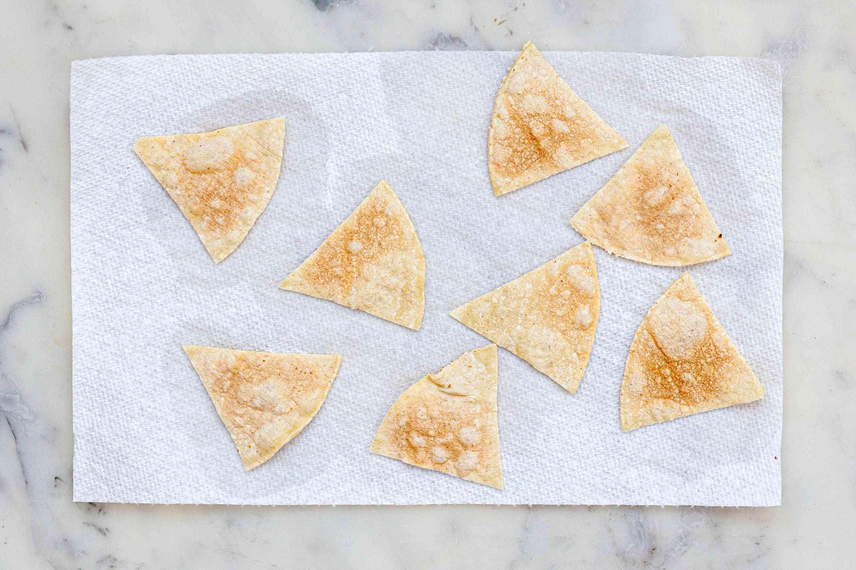 Crispy corn chips on paper towels.