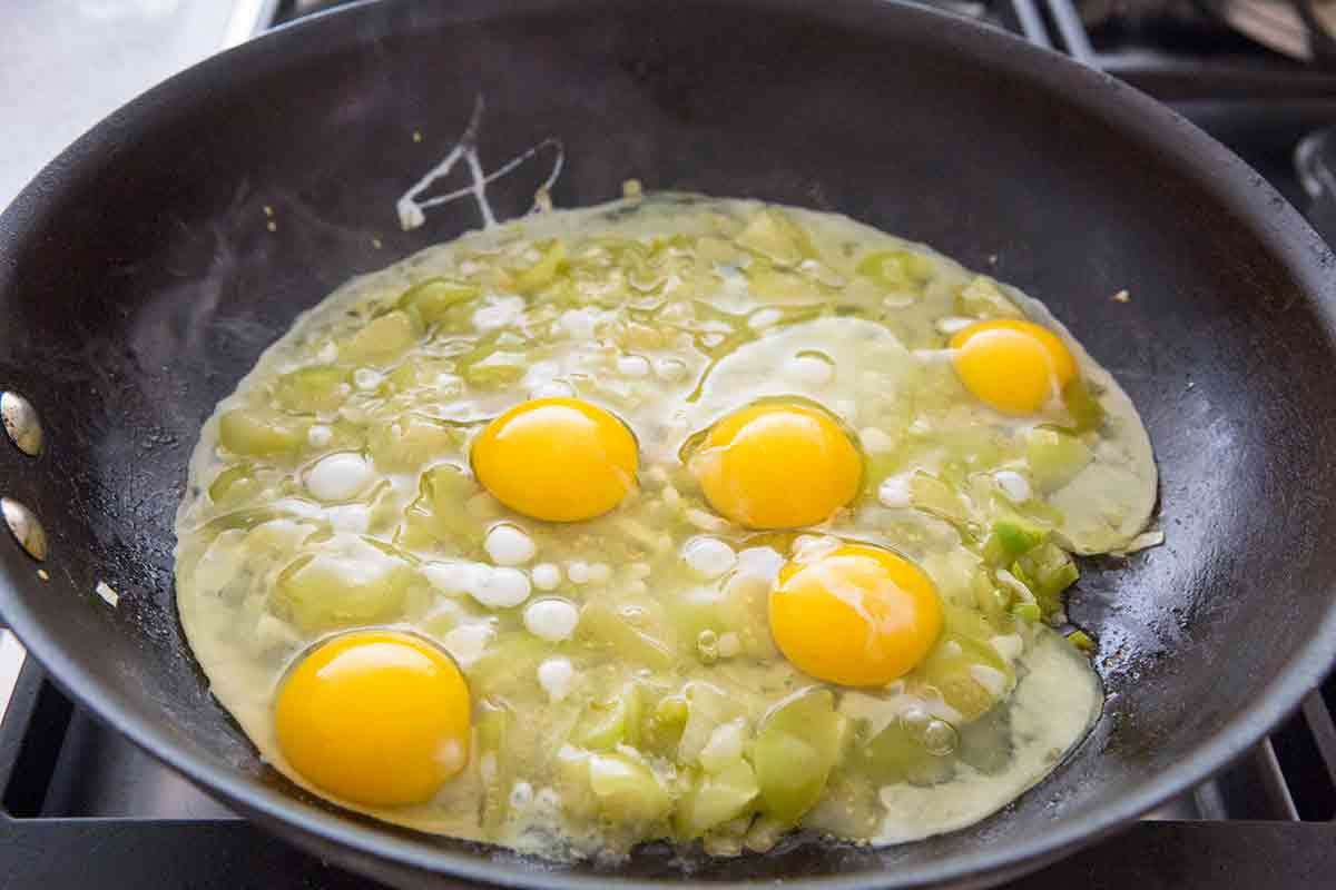 add eggs to tomatillos and onions in pan