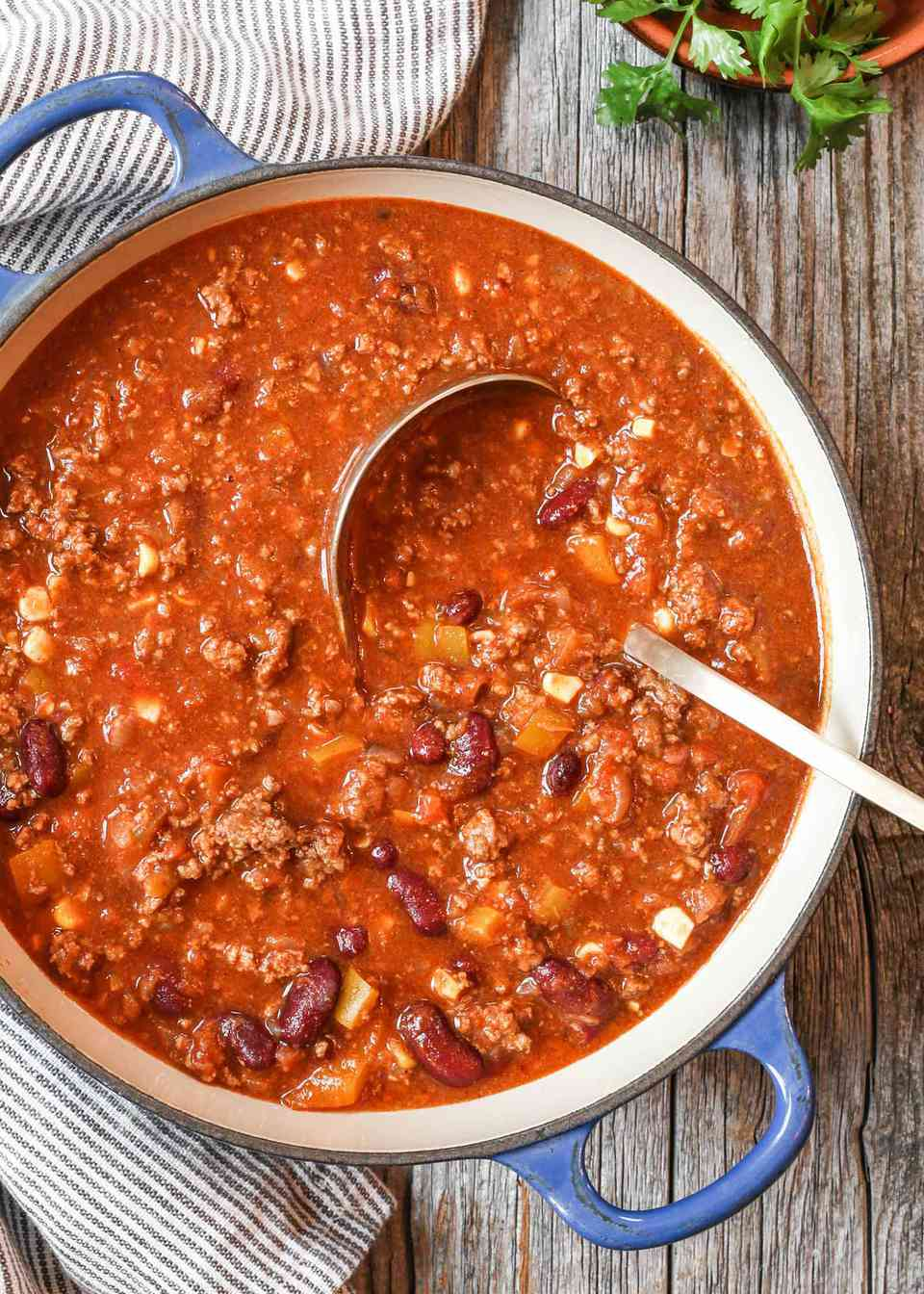Best chili in a dutch oven with a ladle.
