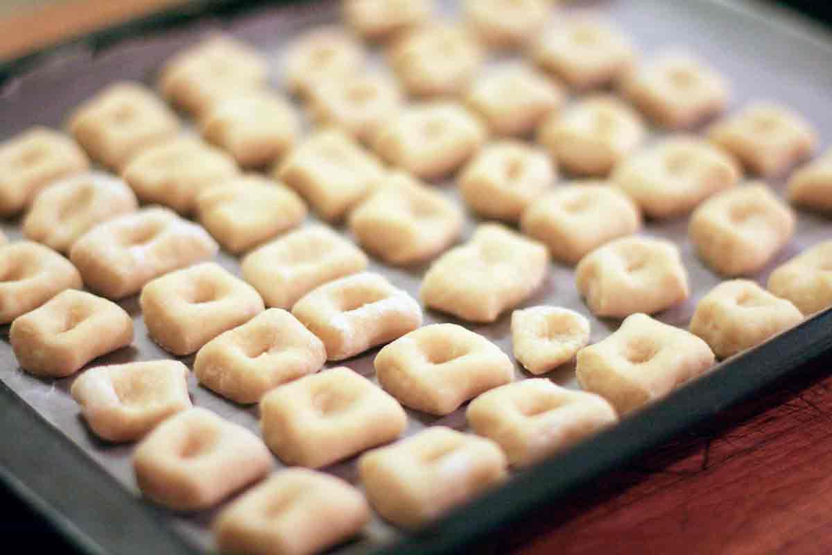 Gnocchi pasta dough pieces on baking dish ready to cook