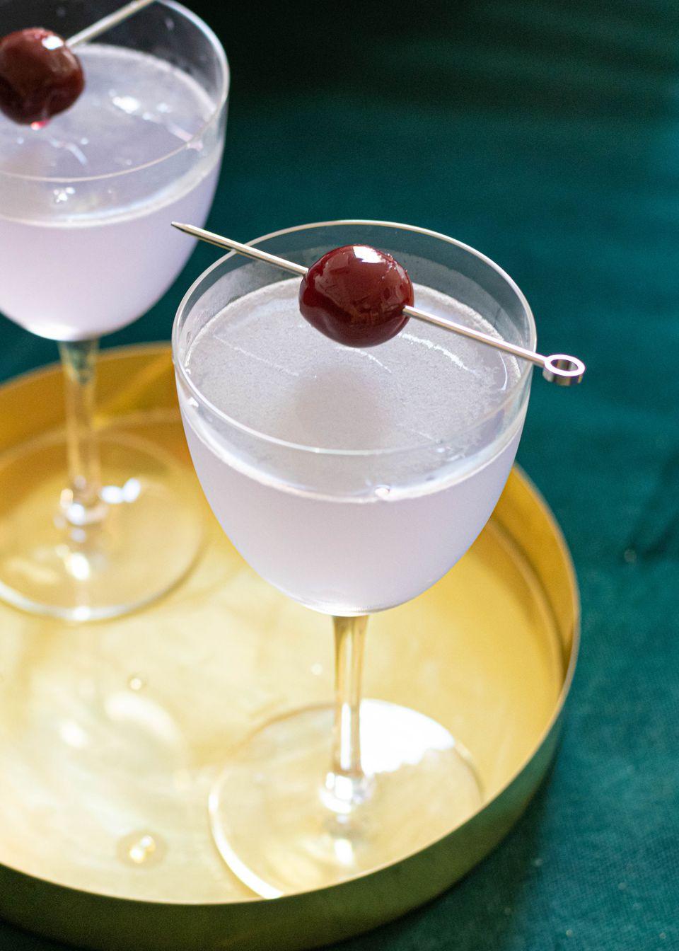 Aviation gin cocktail with cherry garnish