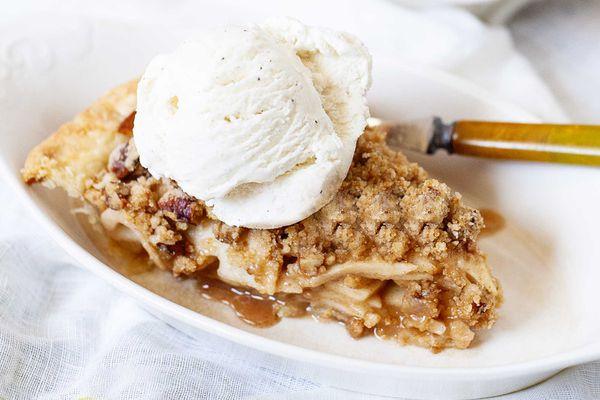 Single slice of easy dutch apple pie with a scoop of ice cream
