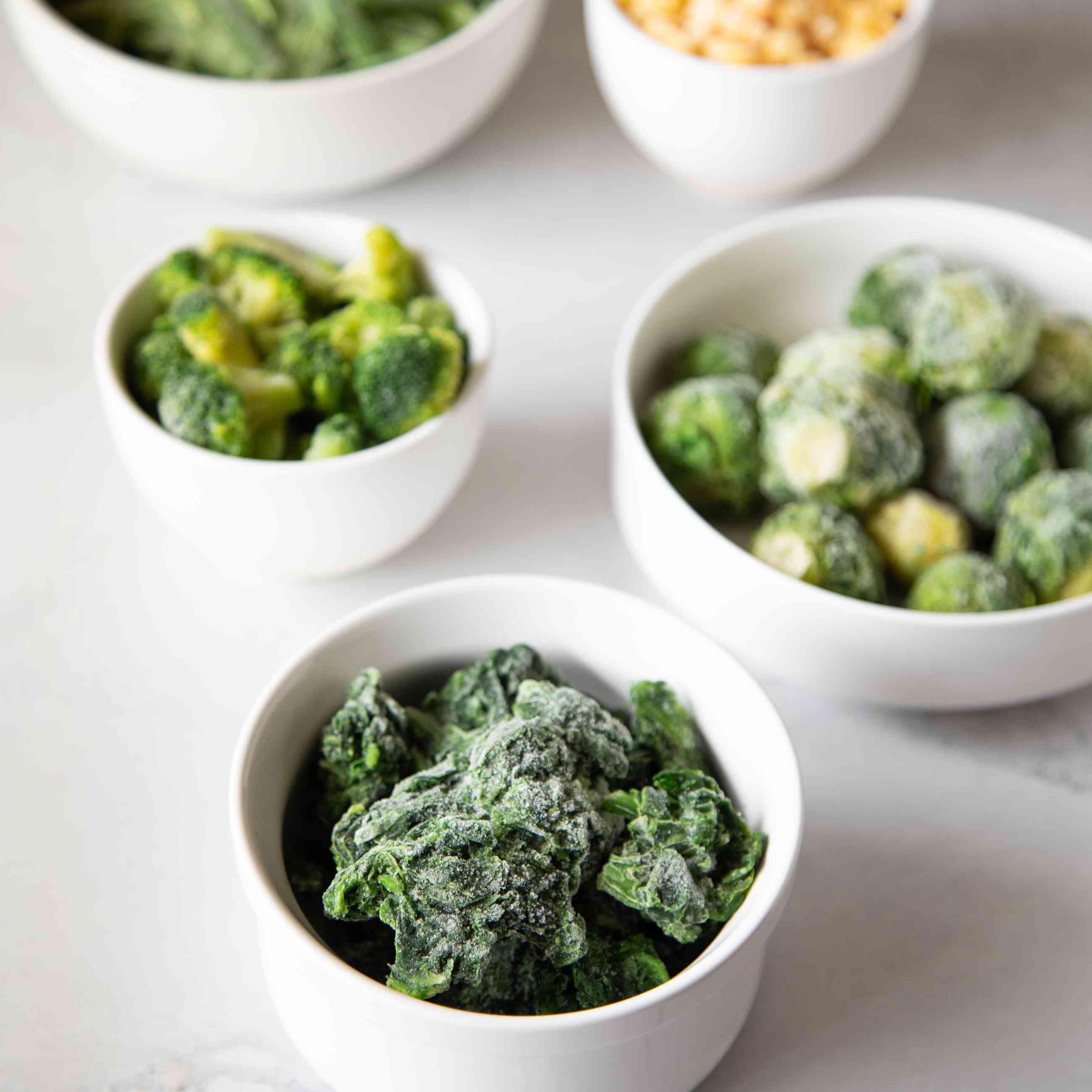 Frozen vegetables in white ramekin bowls
