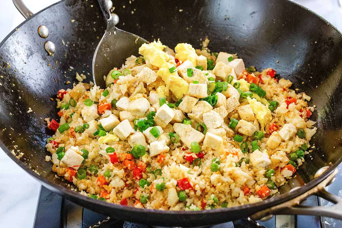 How to Make Cauliflower Fried Rice - vegetable fried rice in wok