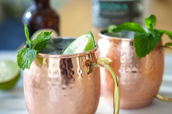Close up of two Moscow Mule Cocktails garnished with mint.