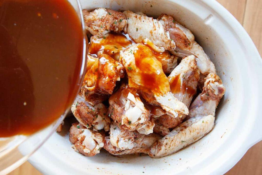 Pour the sauce over the chicken wings for buffalo wings in a crockpot