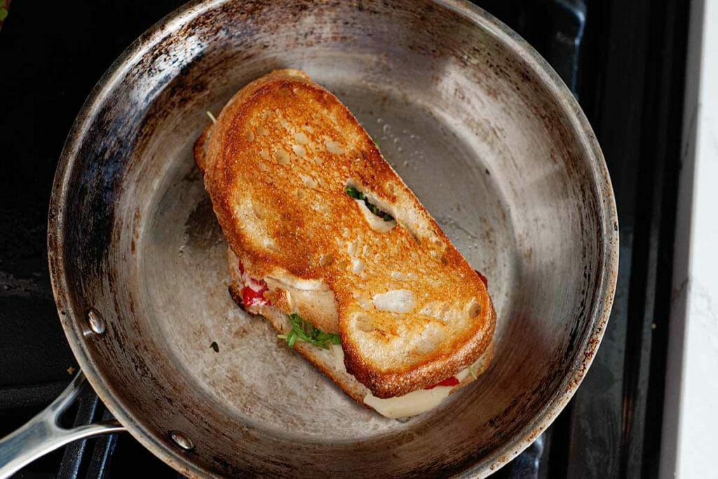 Grill the sandwich in the pan to make a Mozzarella Grilled Cheese Sandwich with Roasted Peppers