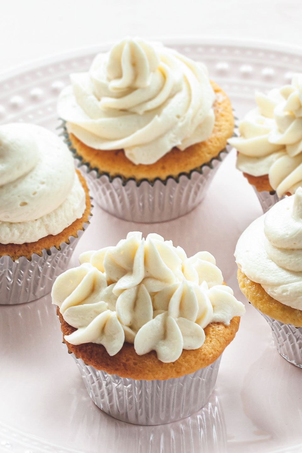 Vanilla Ermine Frosting piped on cupcakes.