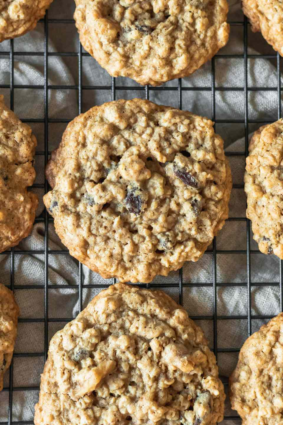 Overhead view of Oatmeal Raisin Cookies cooling on a rack.