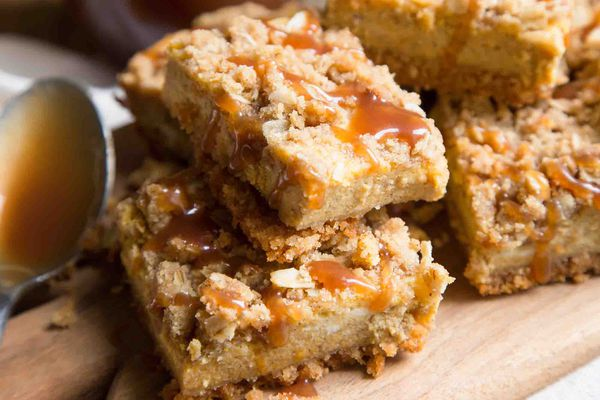 pumpkin cheesecake bars with sterusel topping and caramel sauce