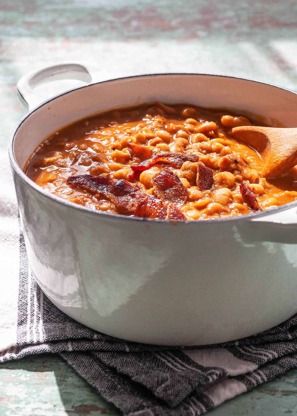 Baked Beans on the Stovetop - baked beans in a pot with a wooden spoon