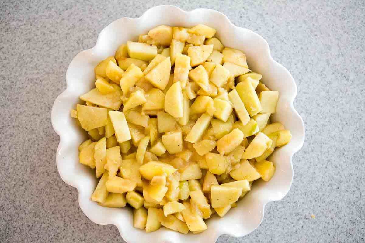 fill pie dish with pre-cooked apples for apple cobbler