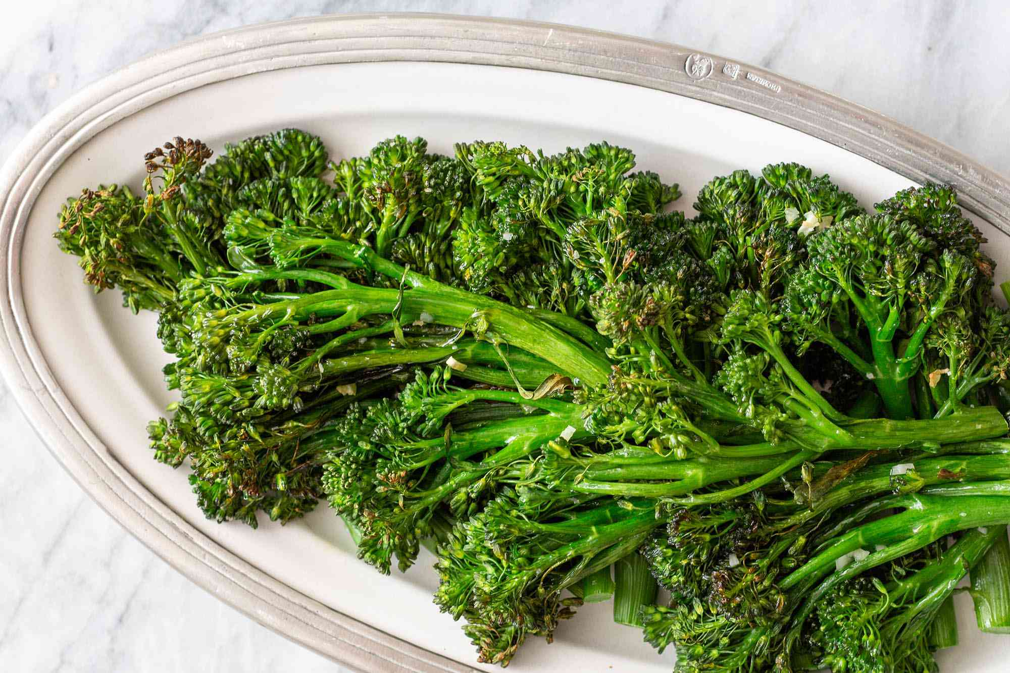 Broccolini roasted and set on a platter.