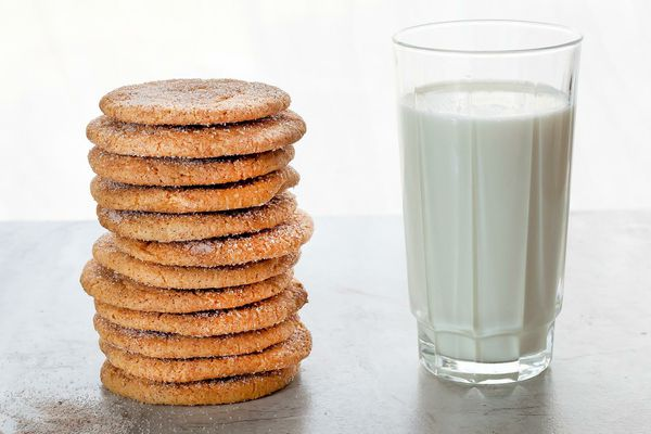 brown sugar snickerdoodles next to a glass of milk