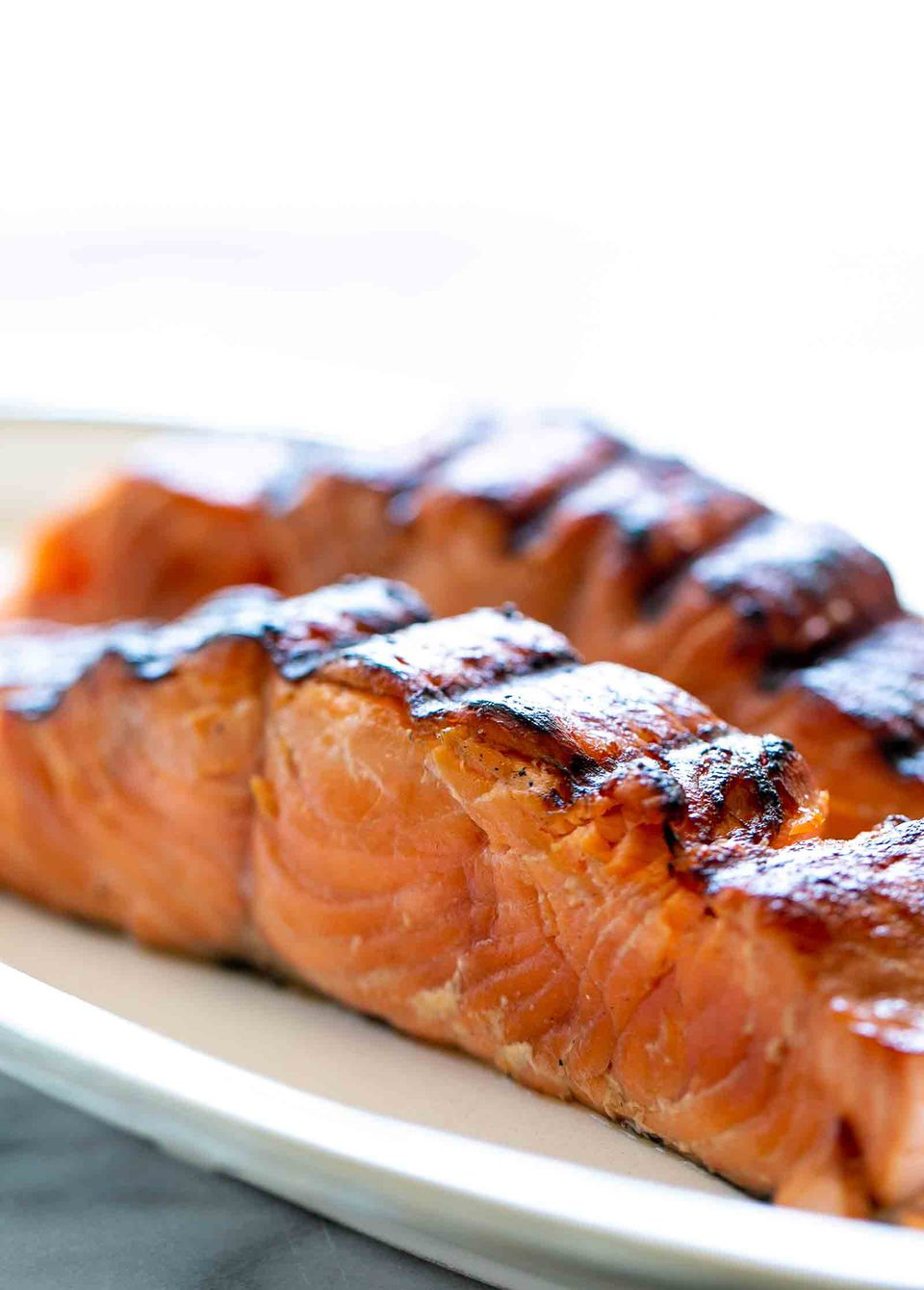 Grilled salmon on a plate, ready to eat