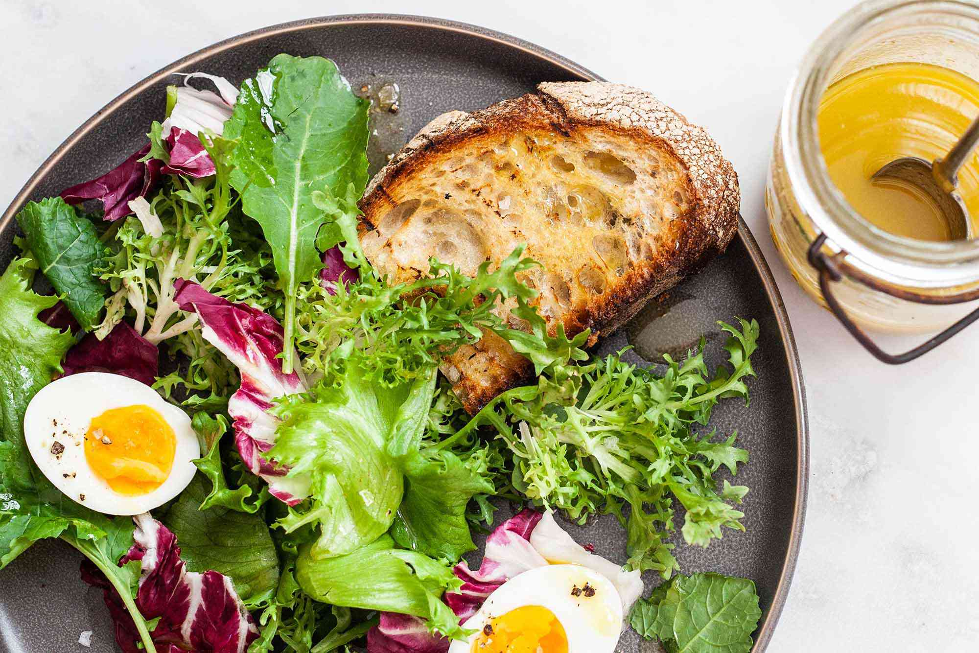 Simple Side Salad -- salad greens with hard boiled eggs and toast