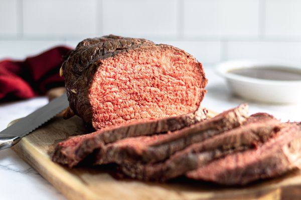 A sliced roast beef cooked to medium rare beef temperature.