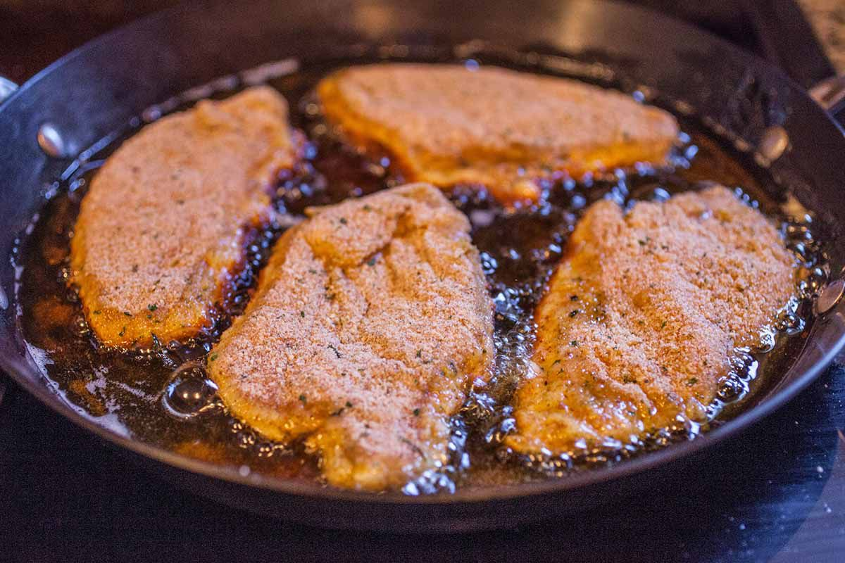 Baked Chicken Parmesan in a Skillet fry the chicken