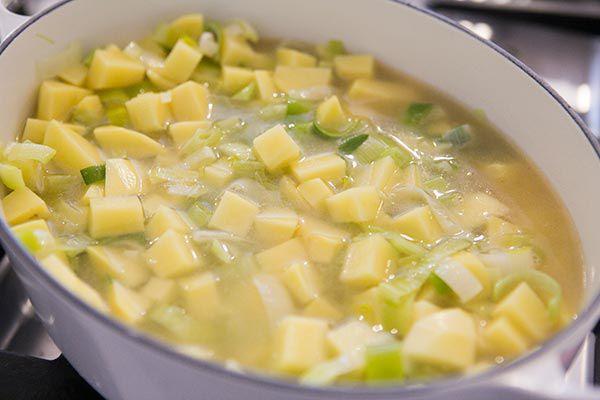 Potato Leek Soup add the potatoes to the soup pot