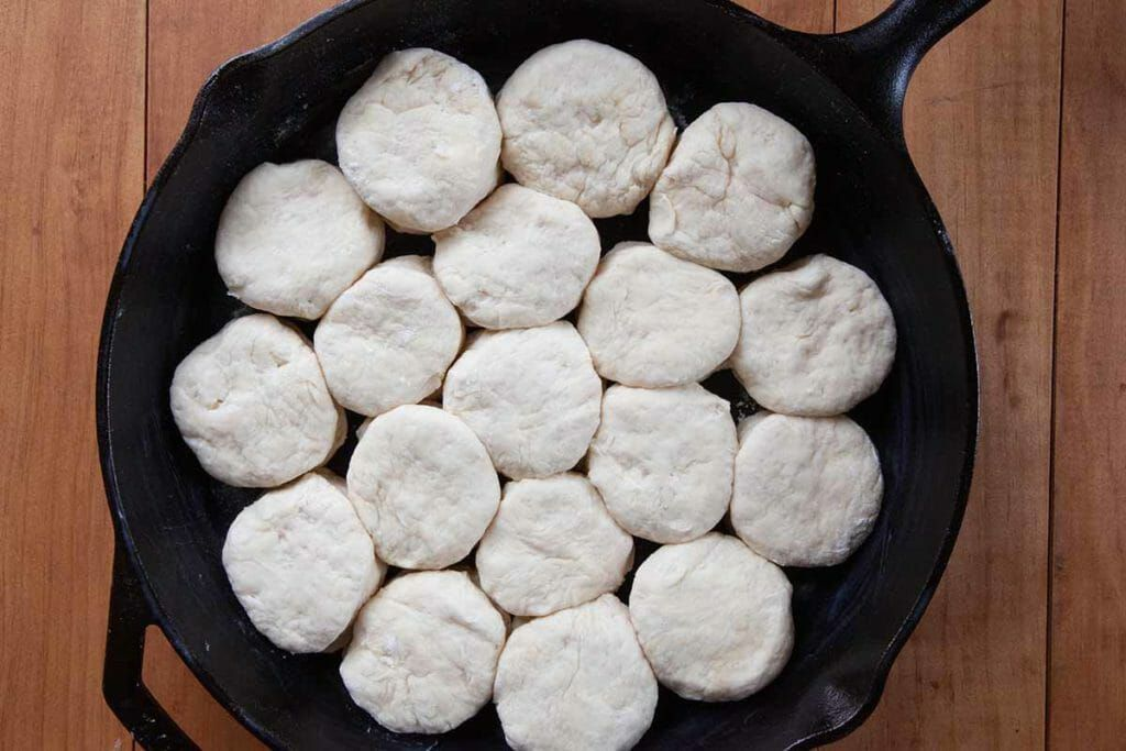 Place angel biscuits in pan making sure they touch