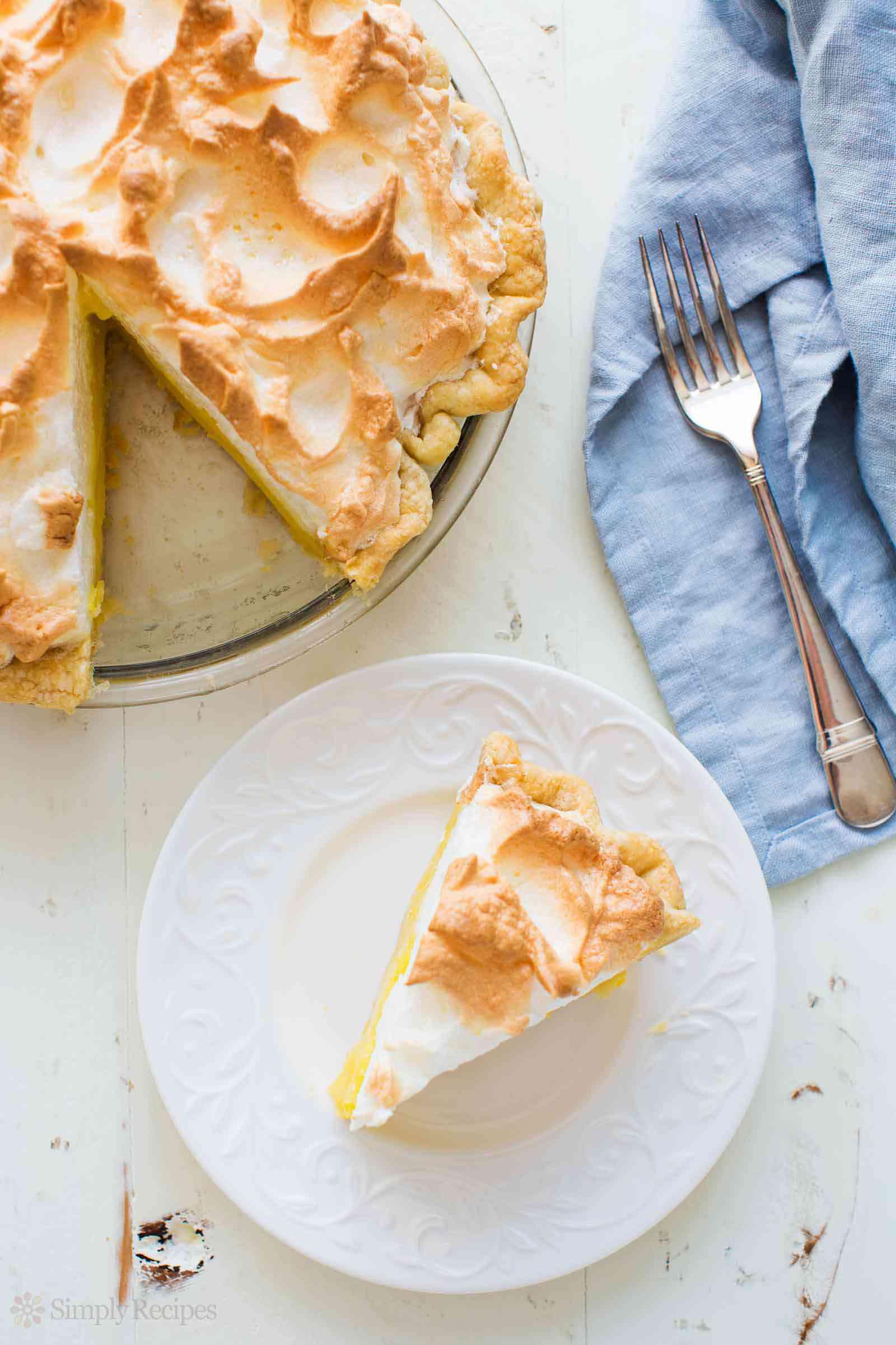 Best Lemon Meringue Pie with slice on plate
