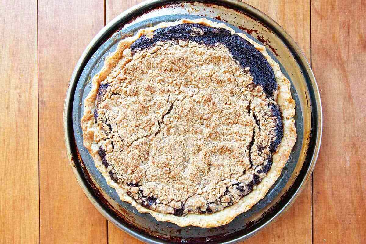 Best shoofly pie with a crumb topping and the filling visible along the edges.