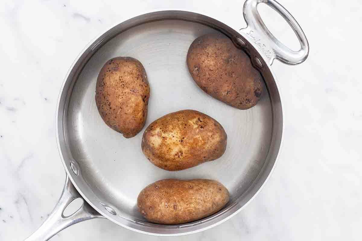 Funeral Potatoes - poach the potatoes