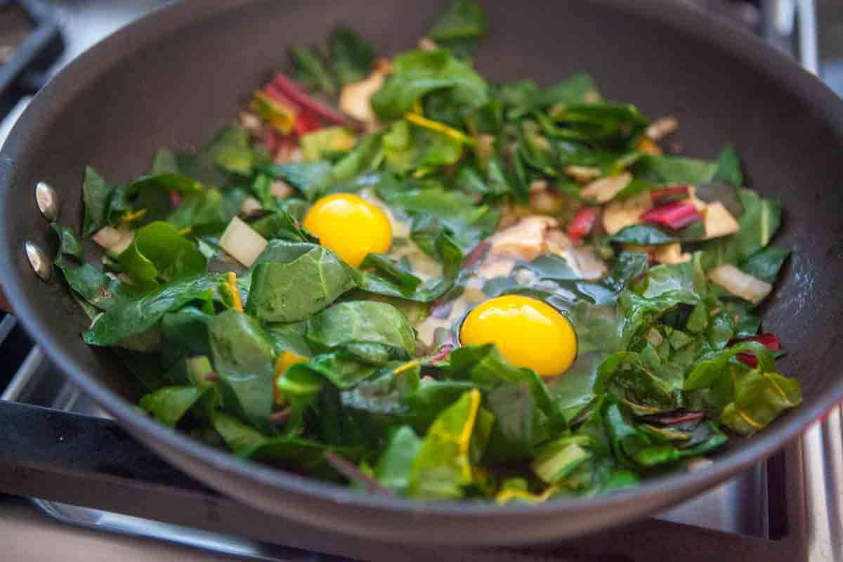 swiss chard raw eggs in pan
