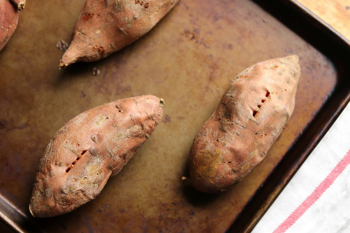 Baked Sweet Potatoes with Chorizo poke the potatoes