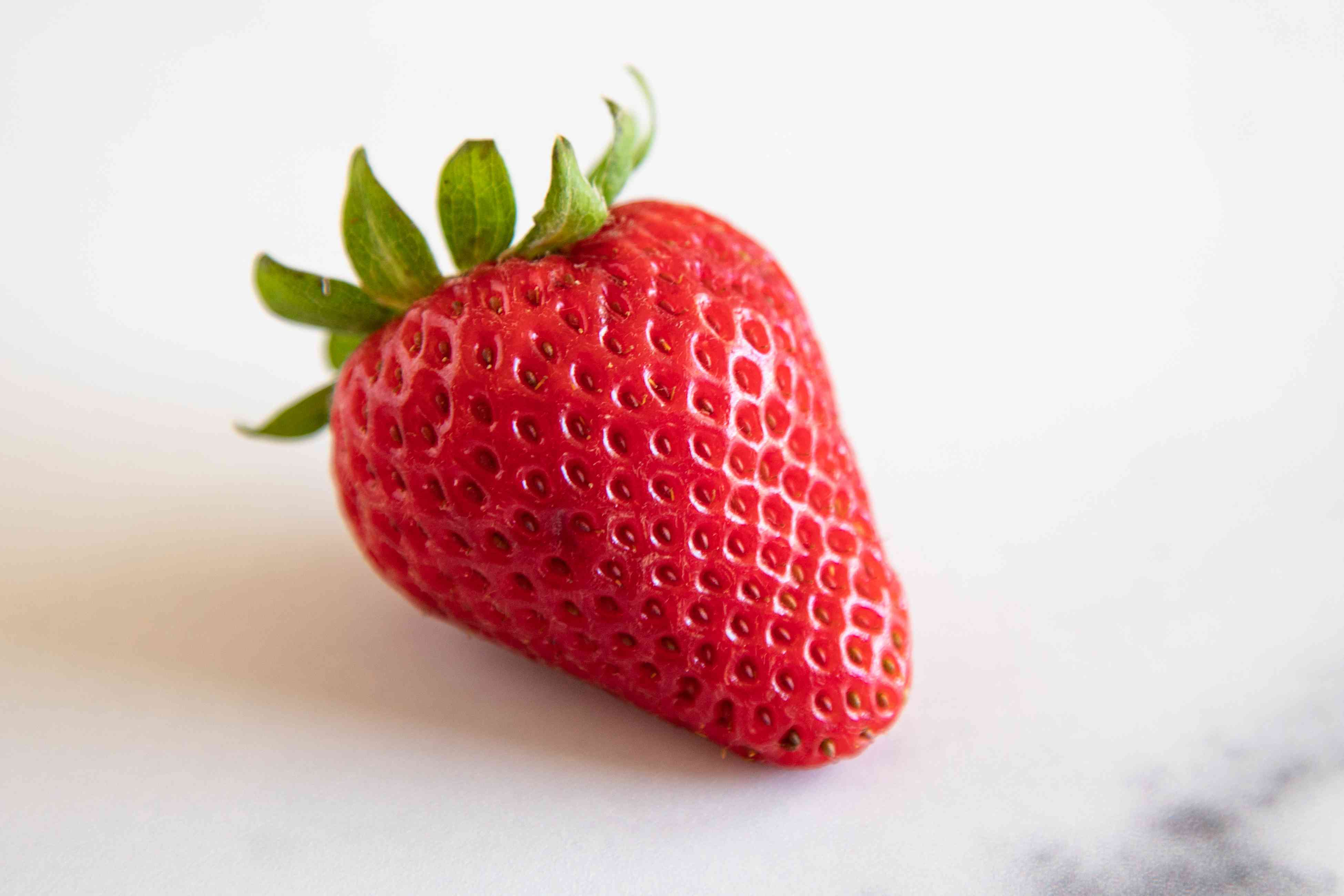 Close up of perfectly red strawberry