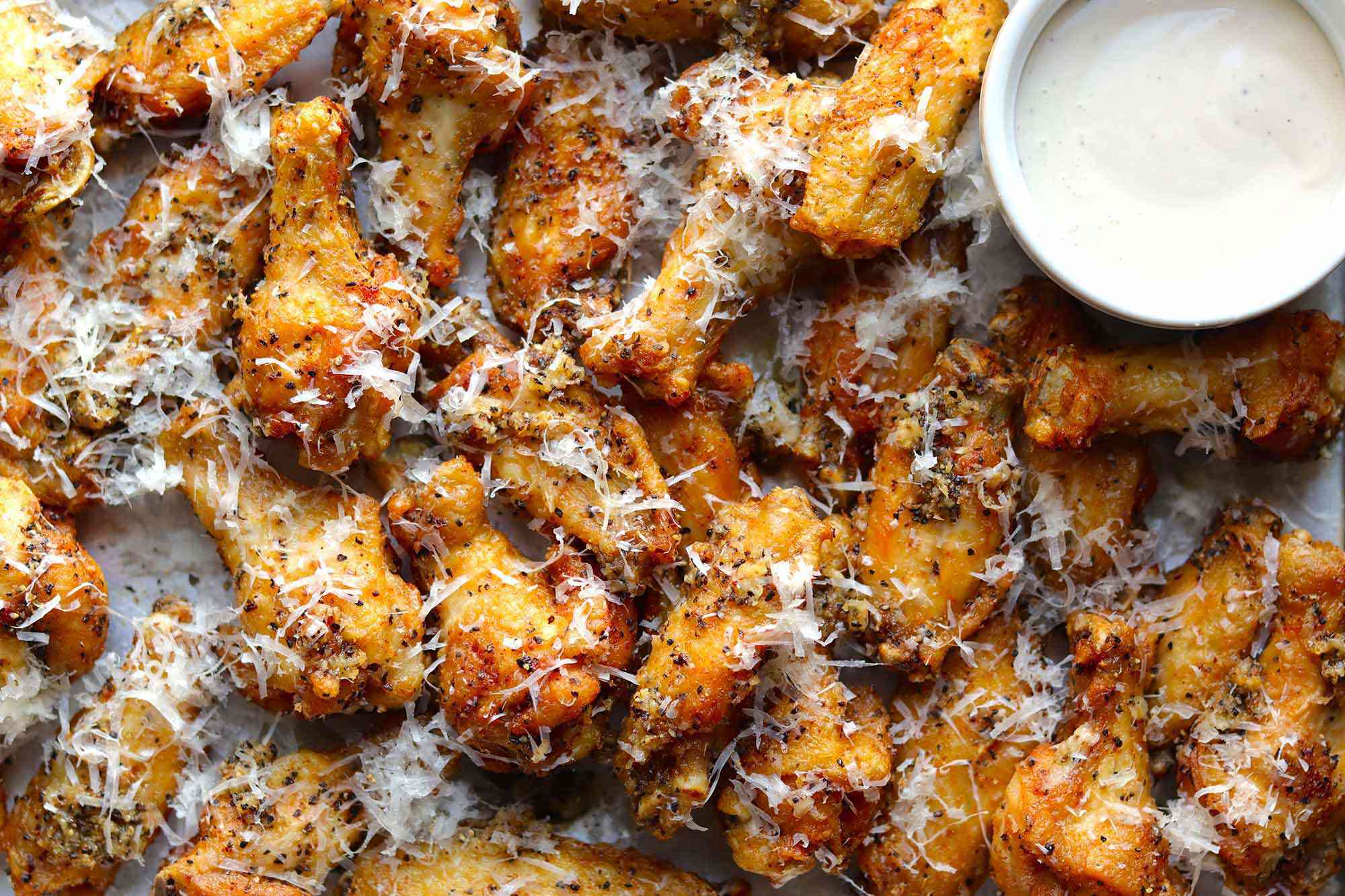 Fried cacio e pepe chicken wings with blue cheese dipping sauce