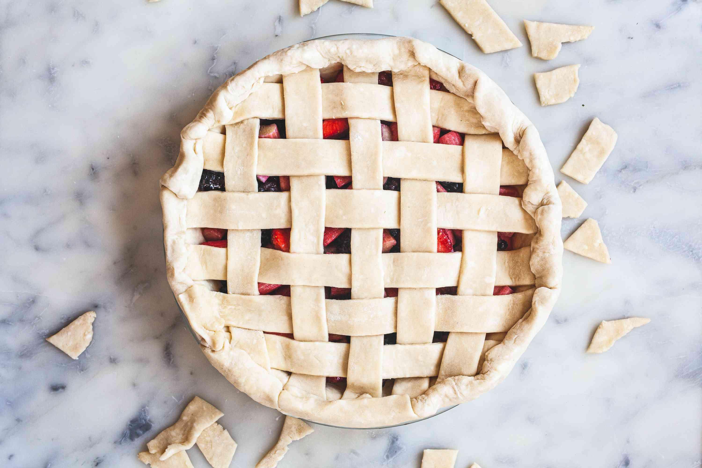 Trimming lattice pie crust.