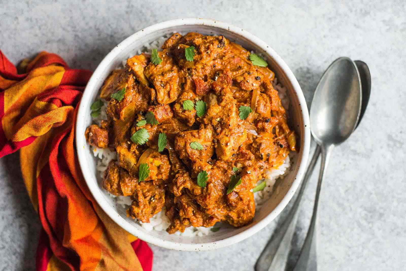 Chicken Tikka Masala finished dish in a bowl with spoons and rice